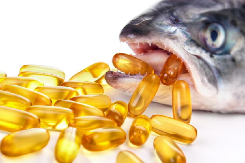 *** Local Caption *** Conceptual image from omega-3 capsules and salmon mouth